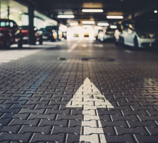 Cars parked in an underground car park - Redwood Business Insurance Services.