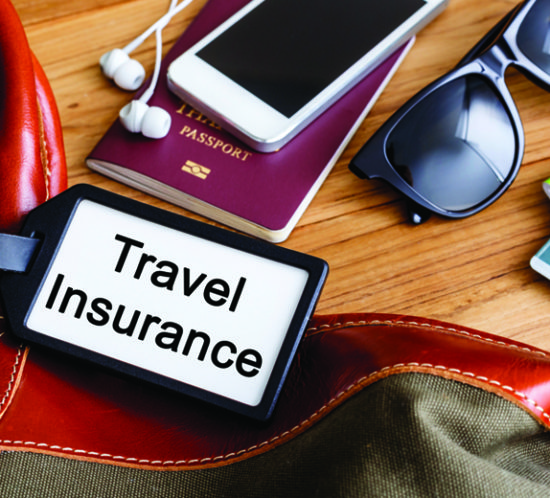 Travel essentials, including a passport and sunglasses - Redwood Business Insurance Services.