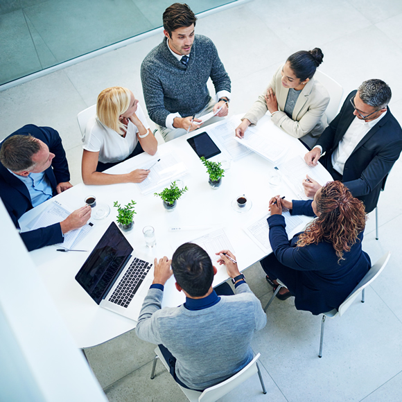 A group of professionals in a meeting at the office - Redwood Business Insurance Services.