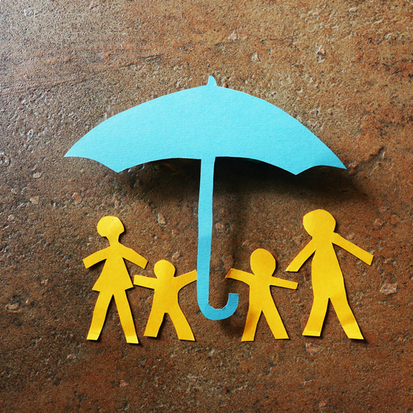 A paper cut-out of a family under an umbrella - Redwood Business Insurance Services.
