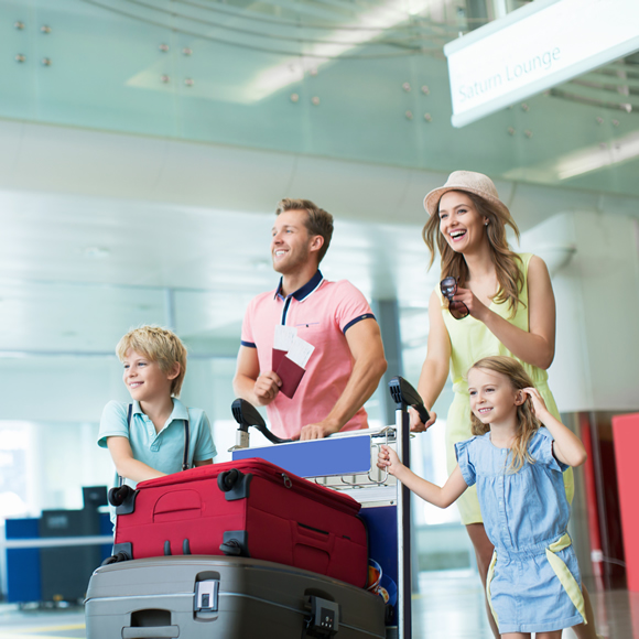 A family at the airport before a holiday - Redwood Business Insurance Services.